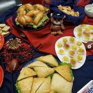 catering spread of sandwiches and deviled eggs
